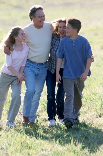 Family in the field : Stock Photo