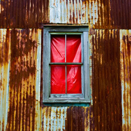 Stock Photo: 1833-138 Close-up of a window in a rusty corrugated iron house