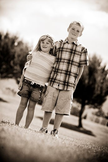 Boy and his sister standing together, California, USA : Stock Photo