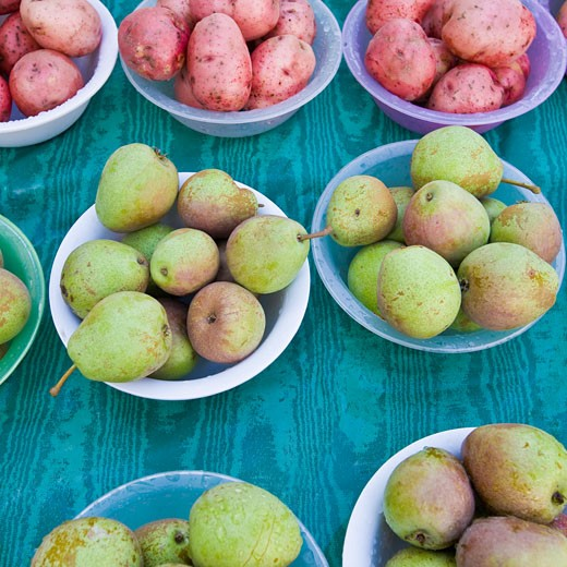 Pears and Potatoes at market : Stock Photo