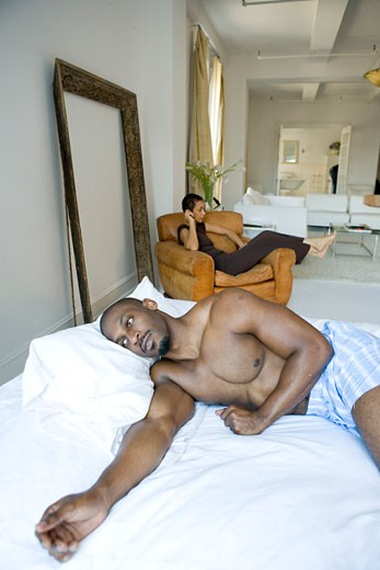 Stock Photo: 1835-218 Mid adult man lying on a bed