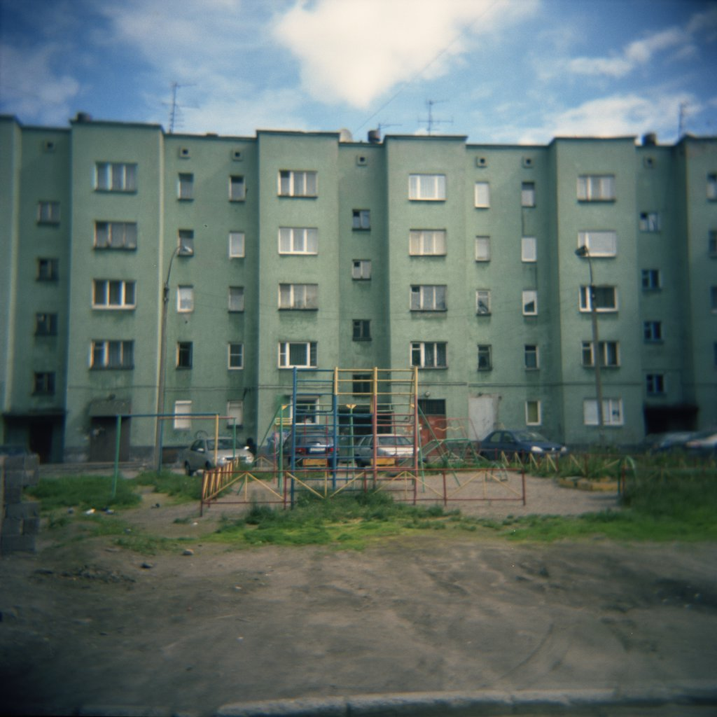 Stock Photo: 1838-10281 Apartment Building and Rundown Playground, Murmansk, Russia,