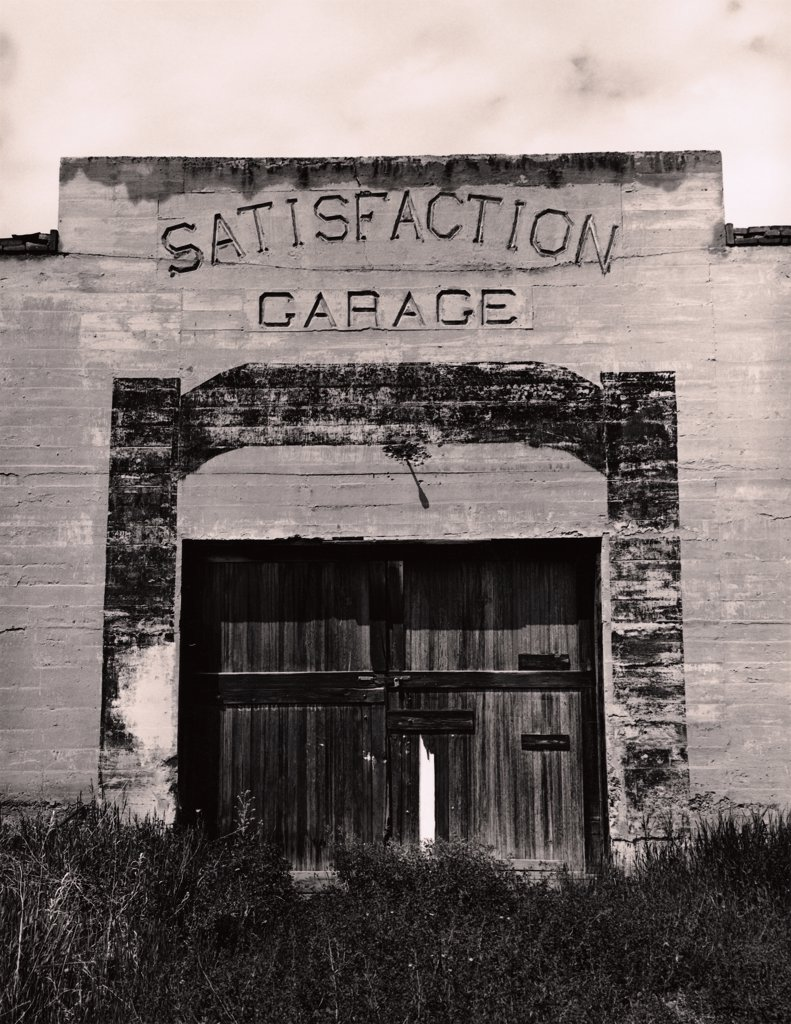 Stock Photo: 1838-1196 Old Satisfaction Garage
