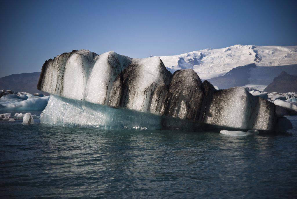 Stock Photo: 1838-12755 Denture-Shaped Iceberg in Jokulsarlon Glacial Lake, Iceland