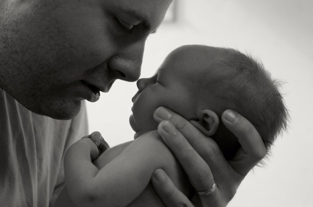Stock Photo: 1838-13089 Father Holding Newborn Son in Hospital, Close-Up