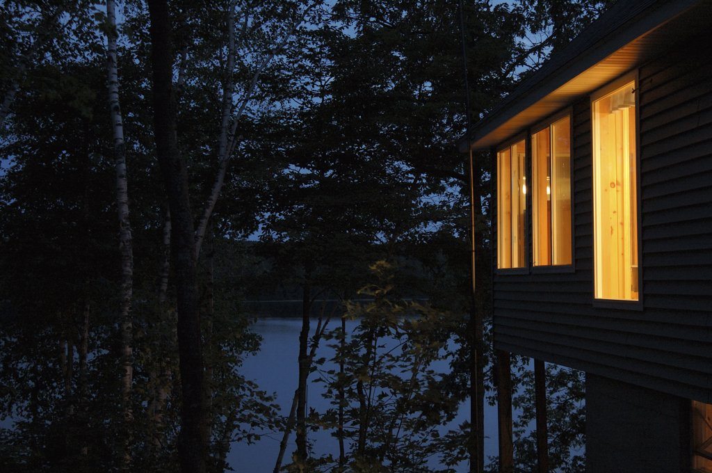 Stock Photo: 1838-13099 Cottage on Lake at Night