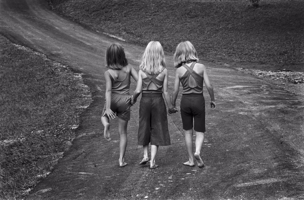 Three Barefoot Girls Holding Hands While Walking Down Path : Stock Photo