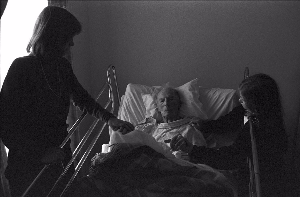 Stock Photo: 1838-13162 Woman and Girl Visiting Elderly Man in Hospital
