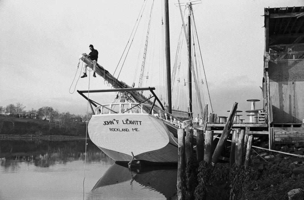 Sailor Adjusting Rigging on Sailboat : Stock Photo