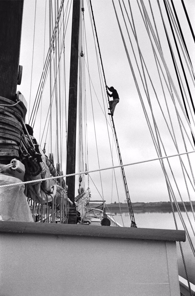 Stock Photo: 1838-13205 Sailor Climbing Rigging on Schooner
