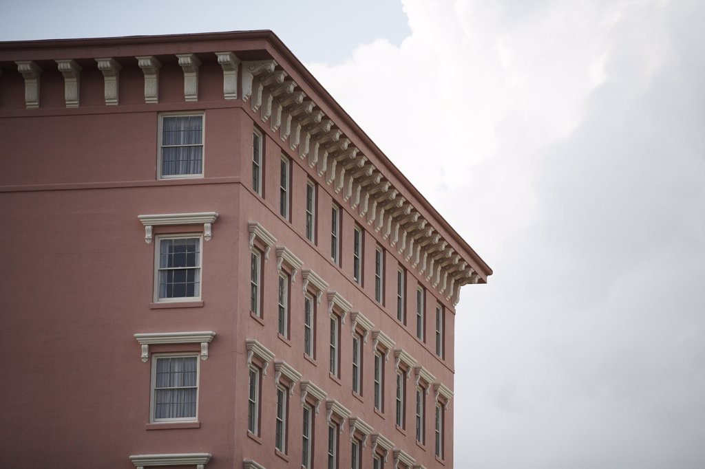 Pink Building with Rows of Windows and Ornamental Roofline, Low Angle View, Charleston, South Carolina, USA : Stock Photo