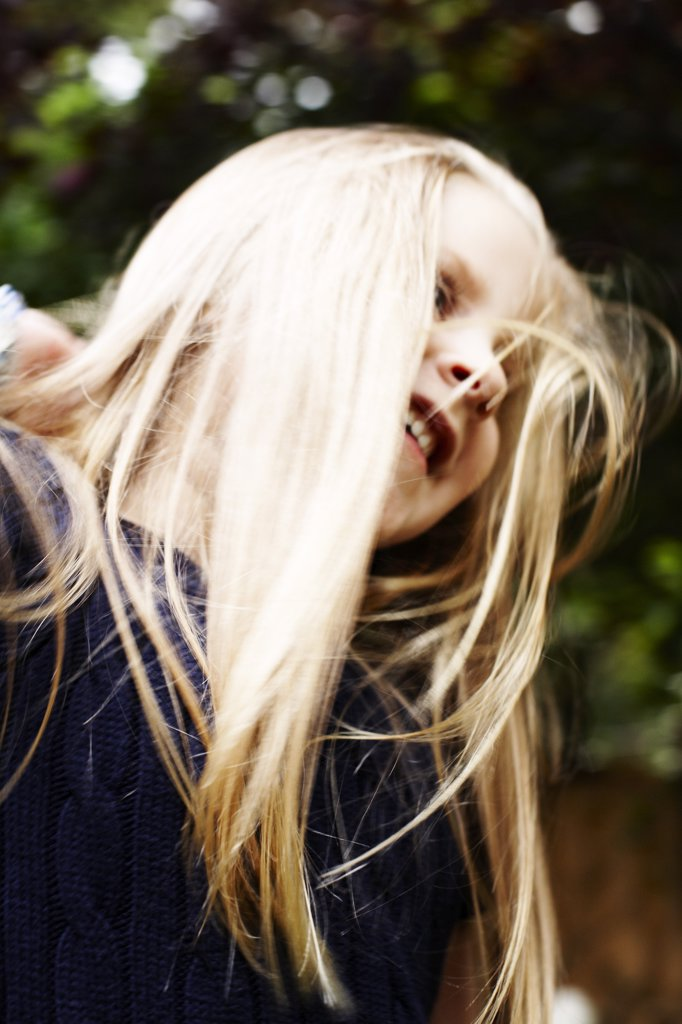 Smiling Blond Girl, Low Angle View : Stock Photo