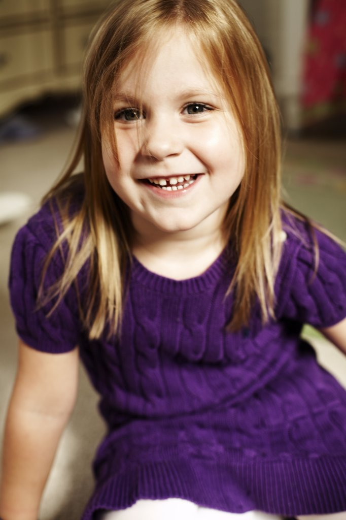 Smiling Girl in Purple Dress : Stock Photo