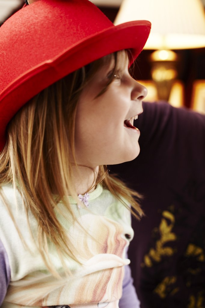Stock Photo: 1838-13558 Young Girl With Red Hat