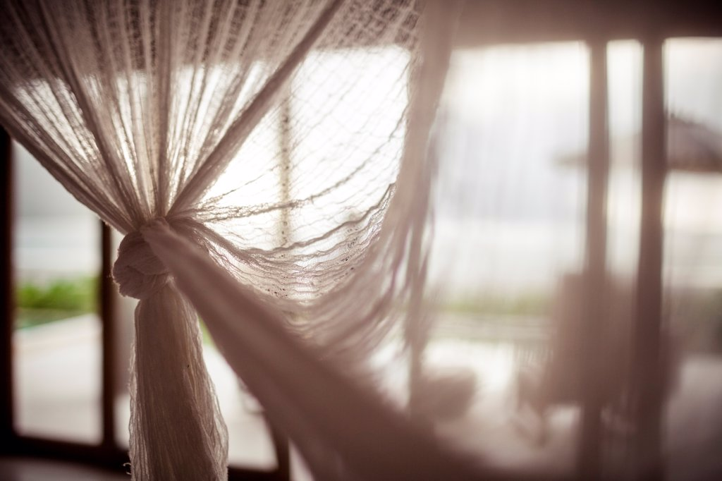 Stock Photo: 1838-13642 Mosquito Netting Over Bed in Hotel Room, Vietnam