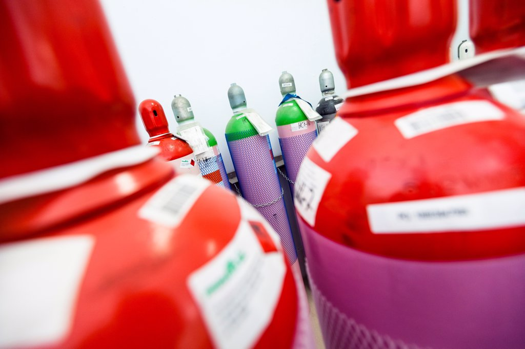 Stock Photo: 1838-13645 Collection of Colorful Nitrogen Gas Containers in Factory