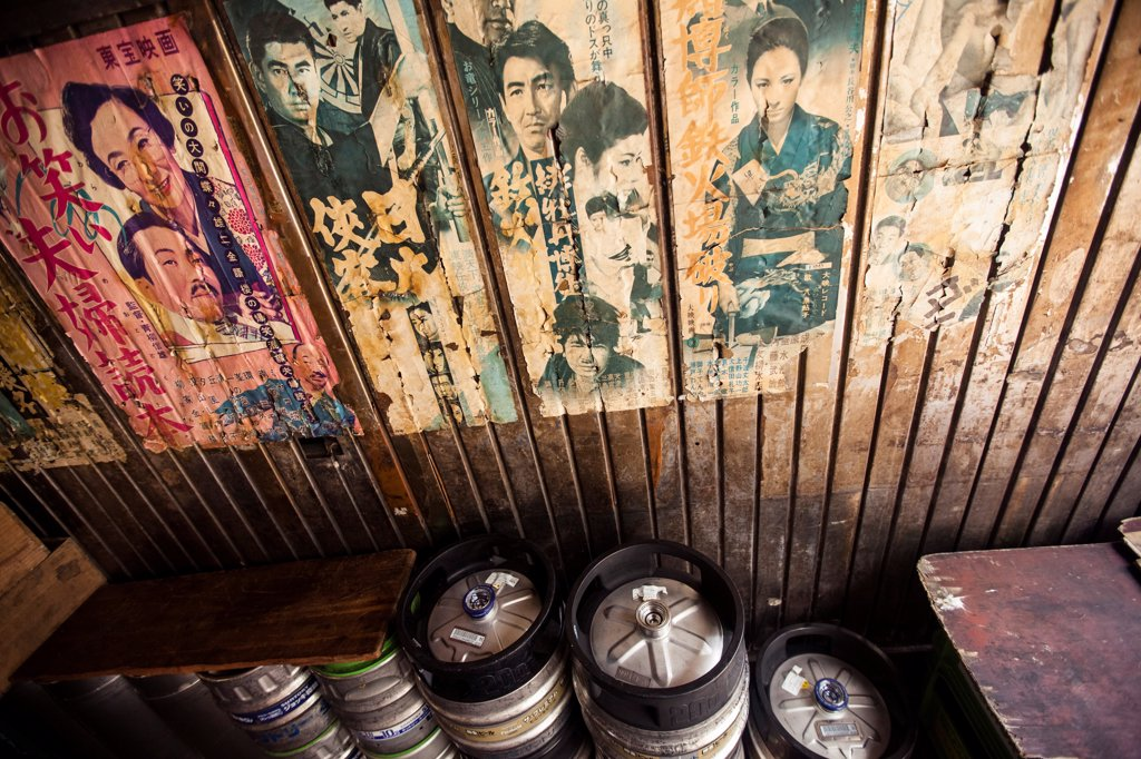 Old Posters and Advertisements With Kegs of Beer in Bar, Tokyo, Japan : Stock Photo