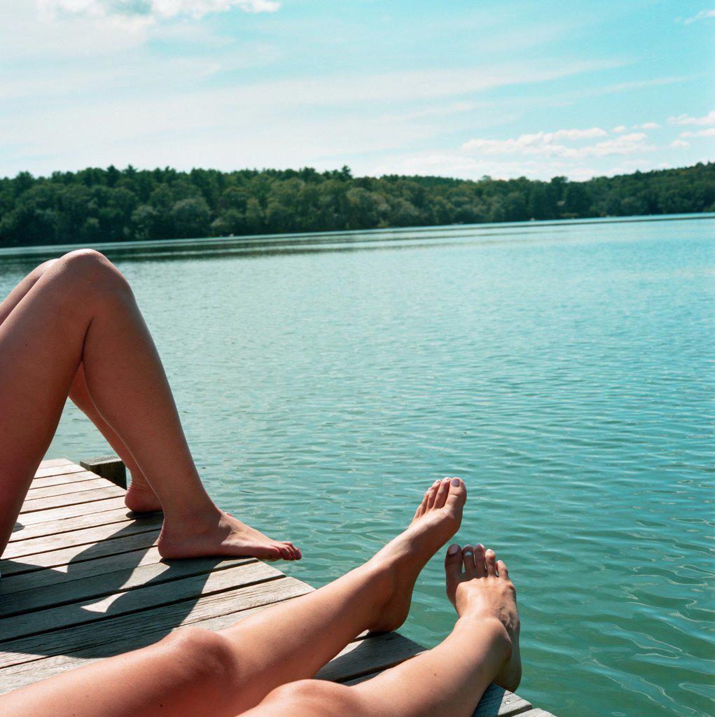 Legs on Dock at Lake : Stock Photo
