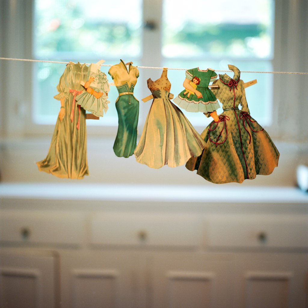 Paper Doll Clothes on Line : Stock Photo
