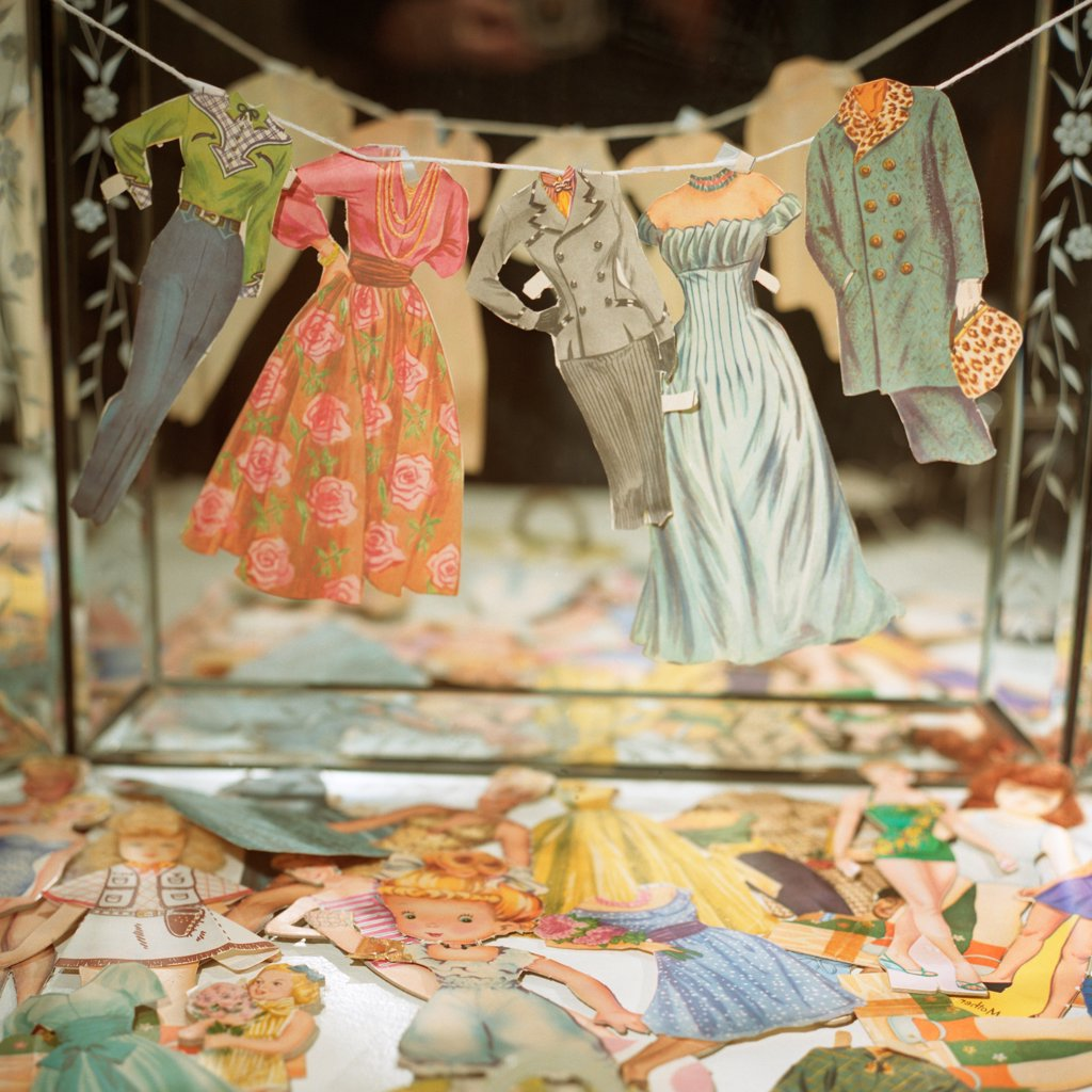 Stock Photo: 1838-13689 Paper Doll Clothes on Line in Front of Mirror