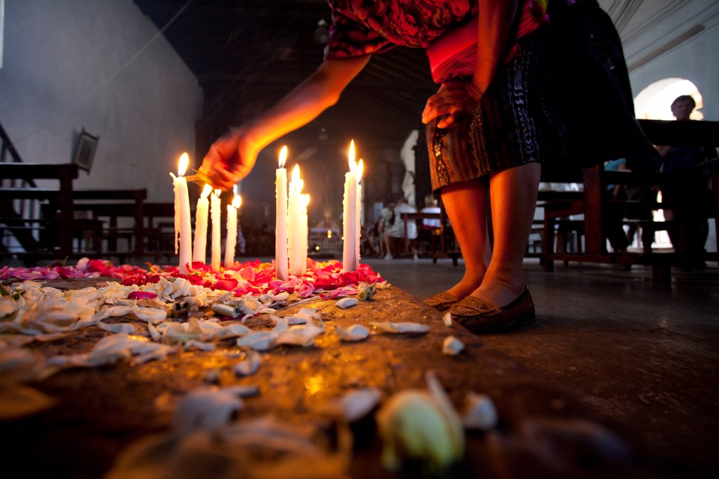 Stock Photo: 1838-13725 Woman Lighting Candles in Church