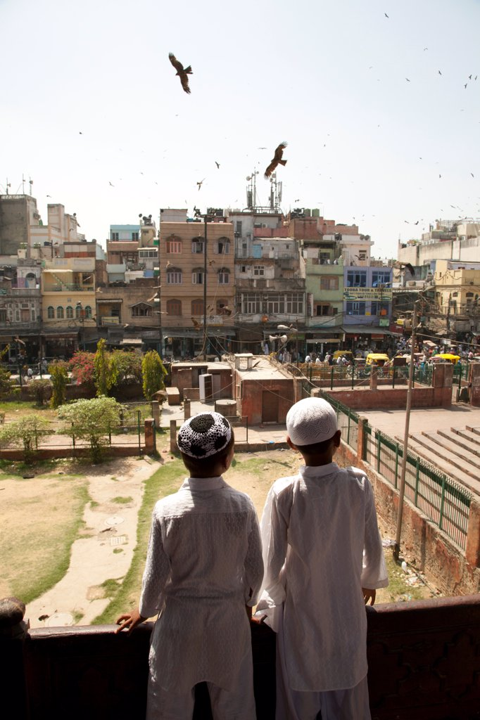 Stock Photo: 1838-13727 Two Boys Looking at Urban Landscape, Old Delhi, India