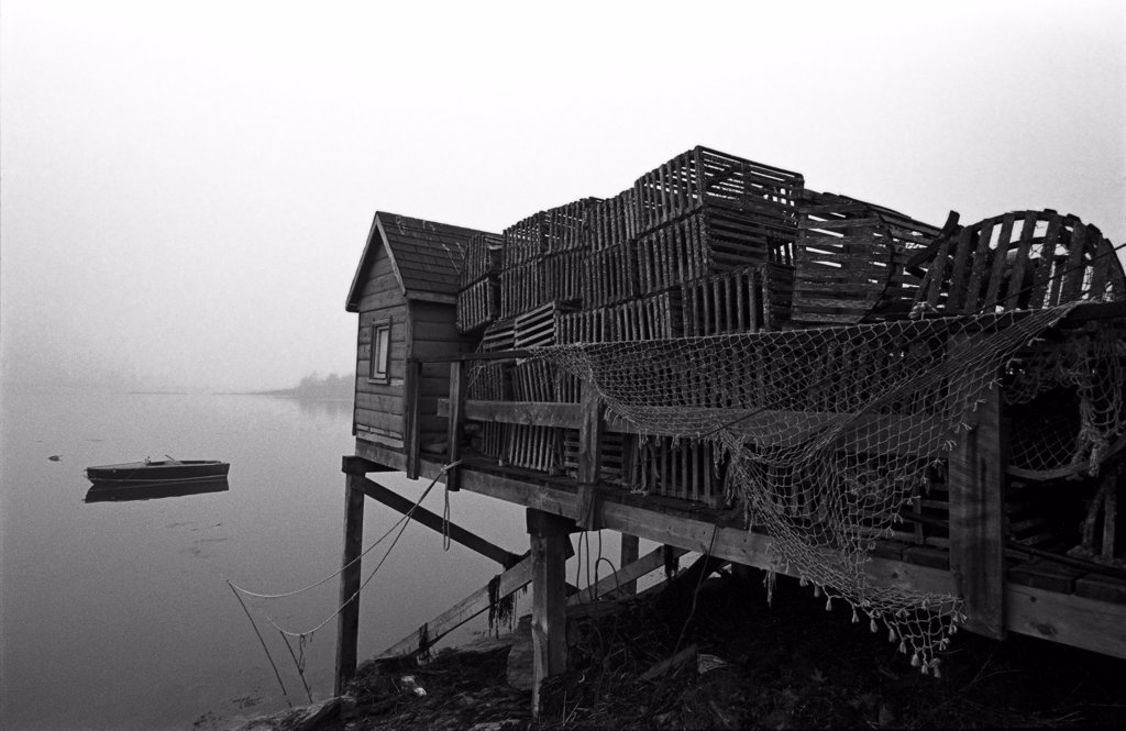 Stock Photo: 1838-13755 Pile of Lobster Crates Behind Shack on Dock, Maine, USA