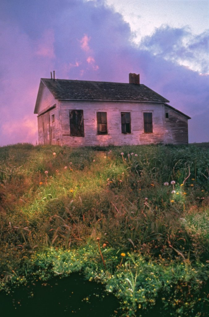 Stock Photo: 1838-13771 Old Abandoned House in Field