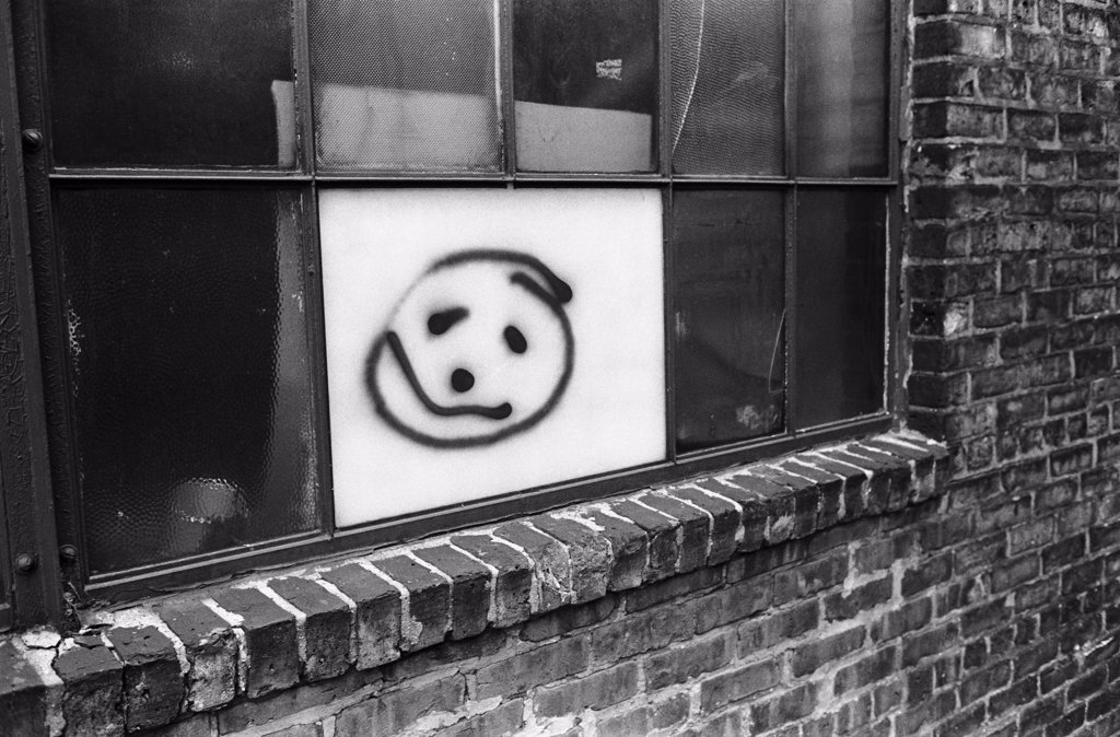 Stock Photo: 1838-13813 Smiley Face Painted on Urban Window