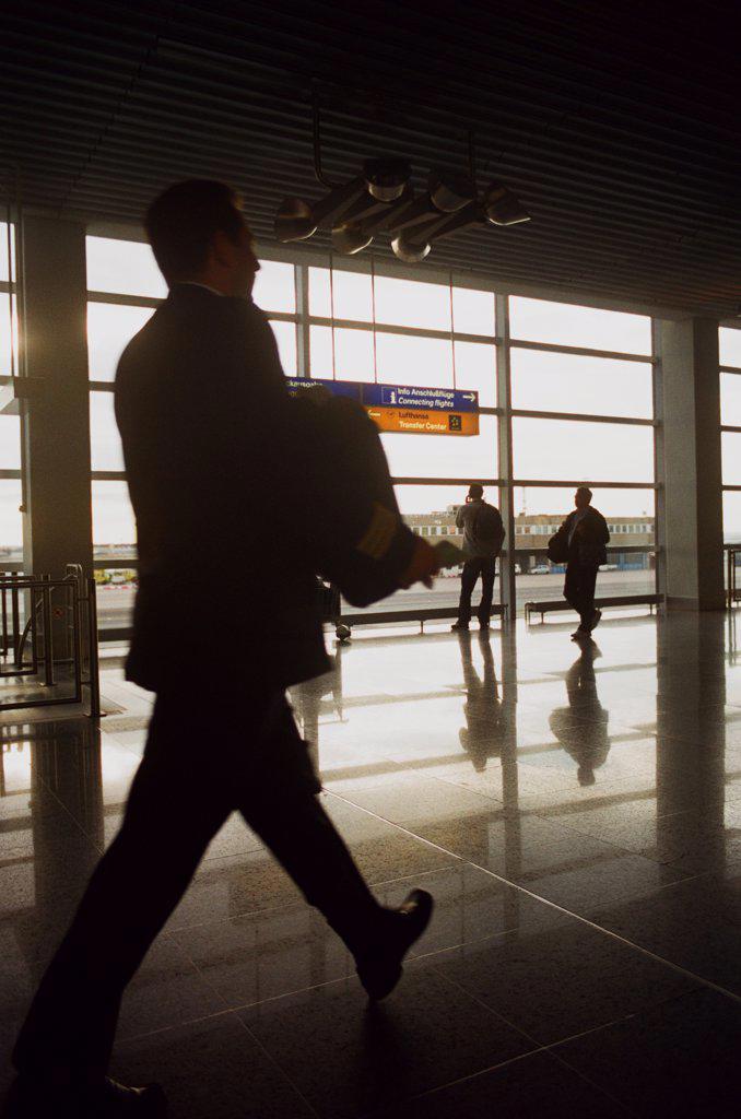 Stock Photo: 1838-13835 Man Walking Through Airport