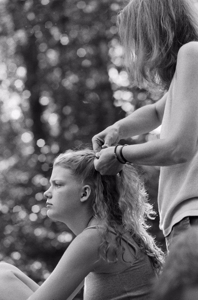 Stock Photo: 1838-13883 Mother Braiding Daughter's Hair