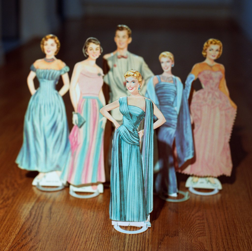 Stock Photo: 1838-13906 Female Paper Dolls in Evening Gowns With One Male Paper Doll in Background