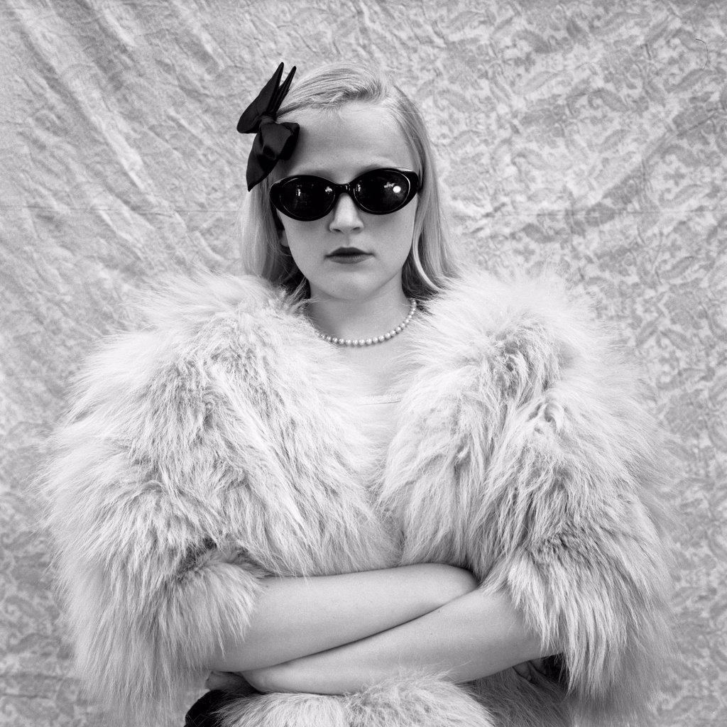Blonde Girl in Sunglasses and Fur Coat : Stock Photo