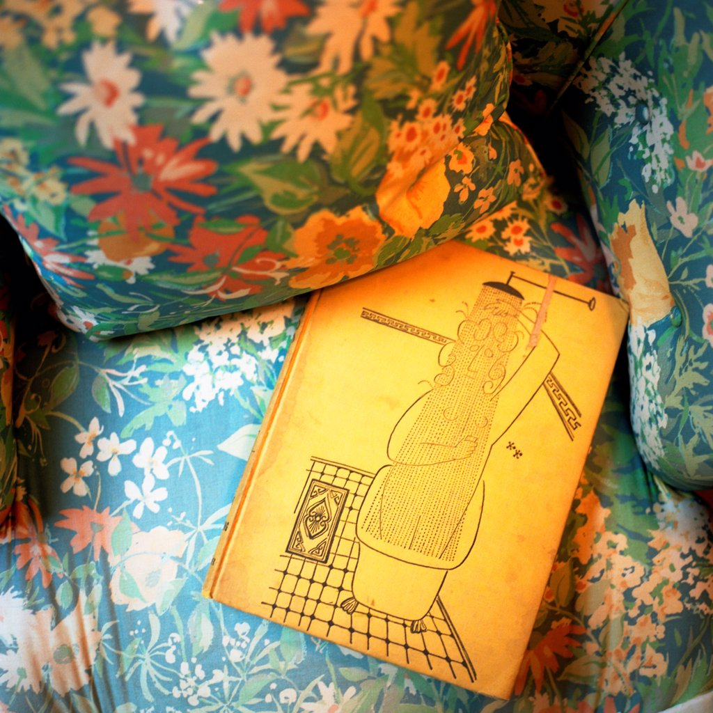 Stock Photo: 1838-13930 Yellow Book on Upholstered Chair