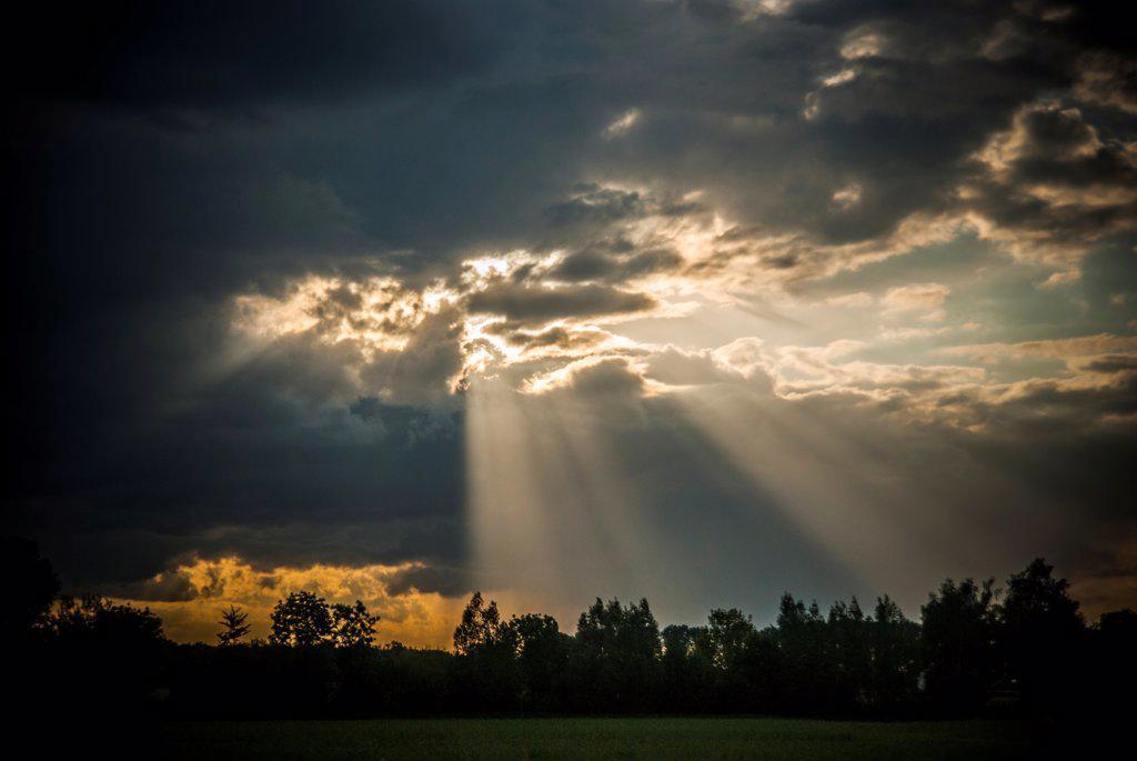 Stock Photo: 1838-13949 Rays of Sun Shining Through Dark Clouds