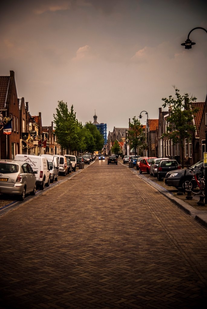 Stock Photo: 1838-13975 Main Street with Parked Cars at Twilight, Workum, Netherlands