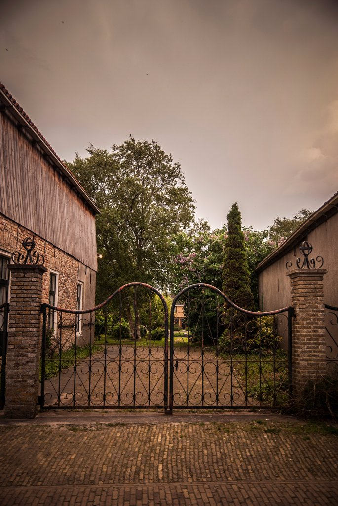 Closed Gate and Trees at Twilight, Workum, Netherlands : Stock Photo
