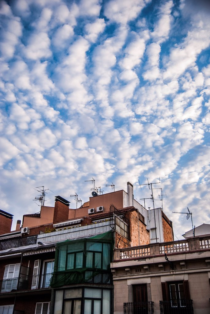 Stock Photo: 1838-14005 Building Rooftop Under Altocumulus Clouds in Sky, Barcelona, Spain