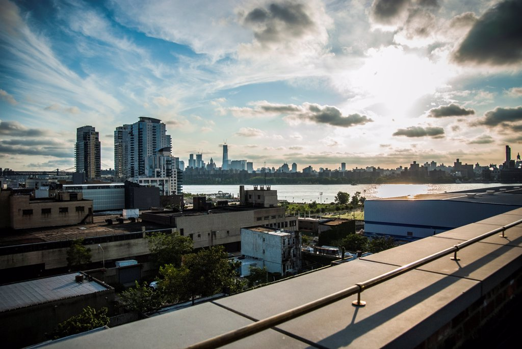 Stock Photo: 1838-14008 Dramatic Sky Over East River Between Williamsburg, Brooklyn and Lower Manhattan