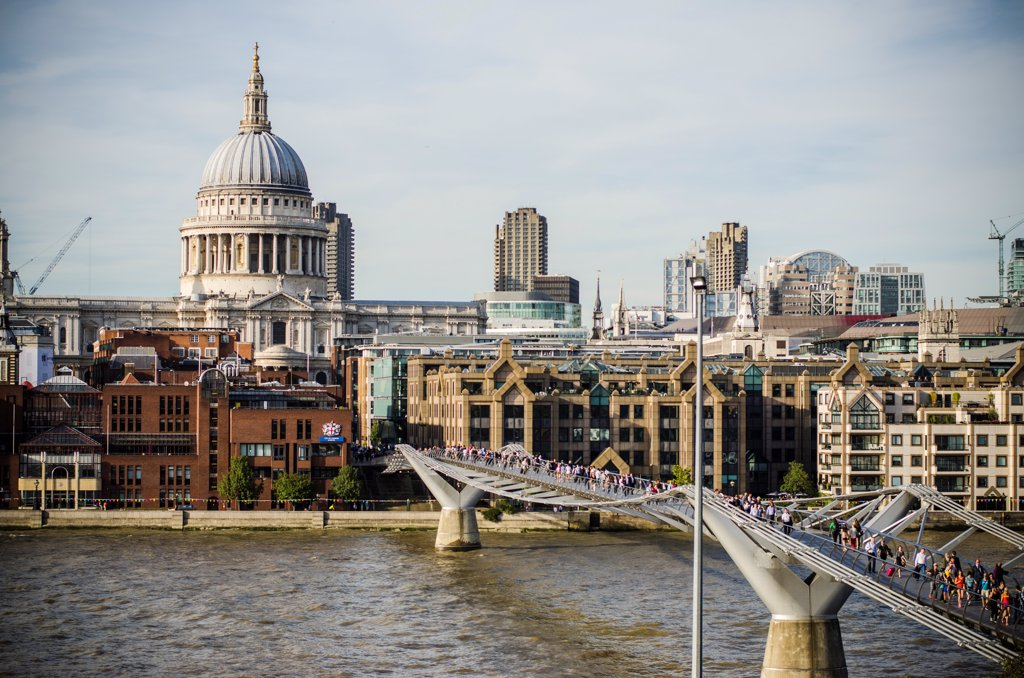 Millennium Footbridge over River Thames, and St. Paul's Cathedral, London, England, UK : Stock Photo