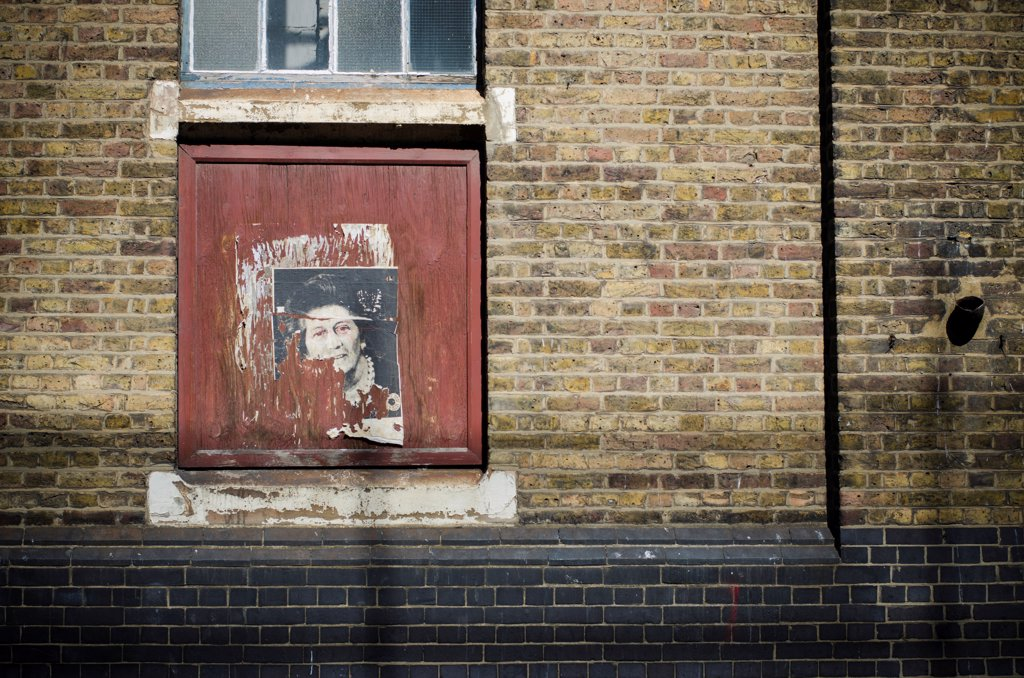Stock Photo: 1838-14020 Remains of a Poster of Margaret Thatcher on Brick Wall, London, England,  UK