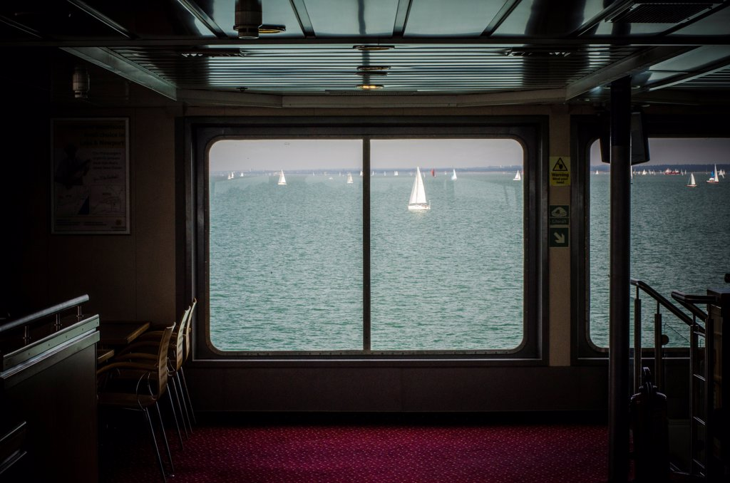 Stock Photo: 1838-14026 View of Sailboats in Bay from Ferry Interior
