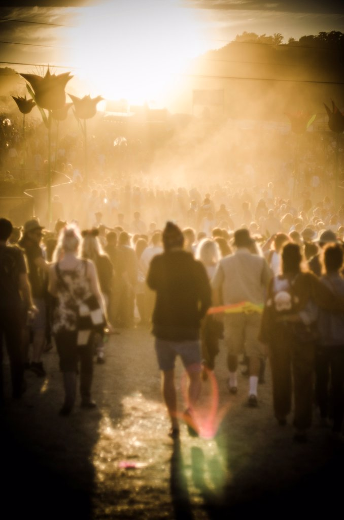Stock Photo: 1838-14029 Crowd of Young People Moving Through Summer Music Festival in Warm Light, Isle of Wight, UK