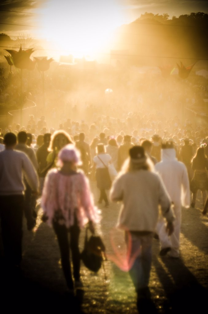 Crowd of Young People Moving Through Summer Music Festival in Warm Light, Isle of Wight, UK : Stock Photo