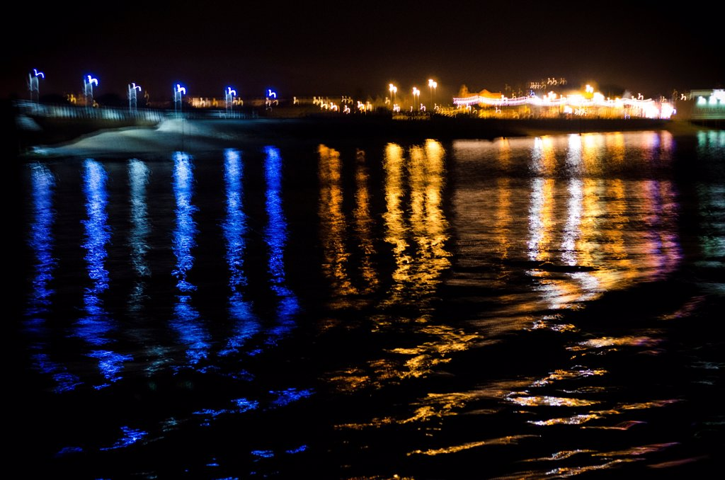 Rainbow of Light Reflections in Water at Night : Stock Photo