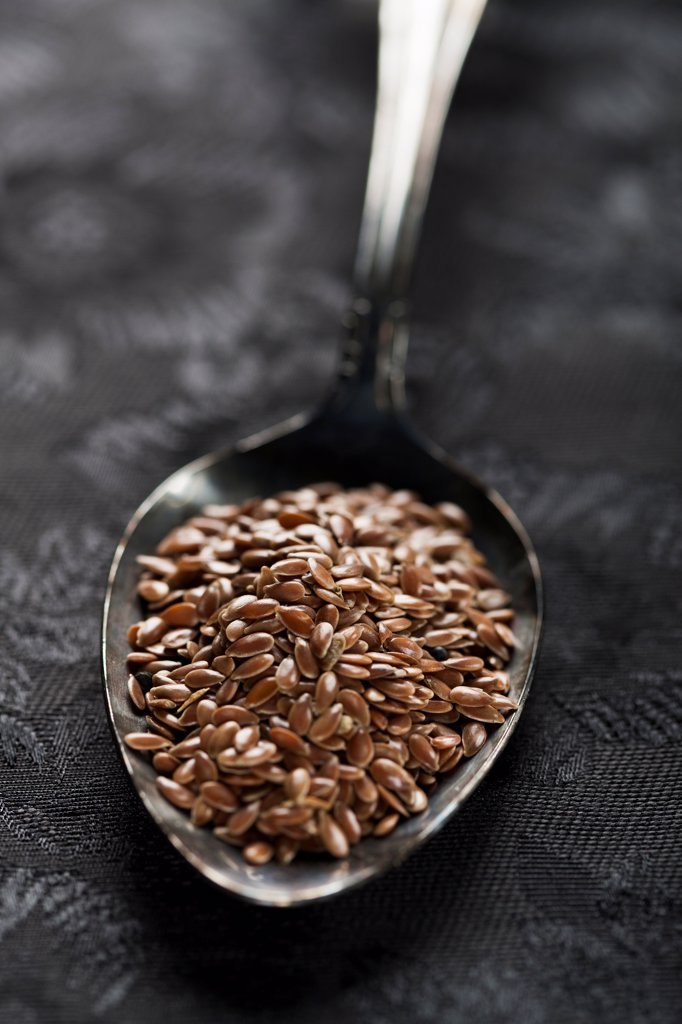 Stock Photo: 1838-14038 Flaxseeds in Spoon, Close Up