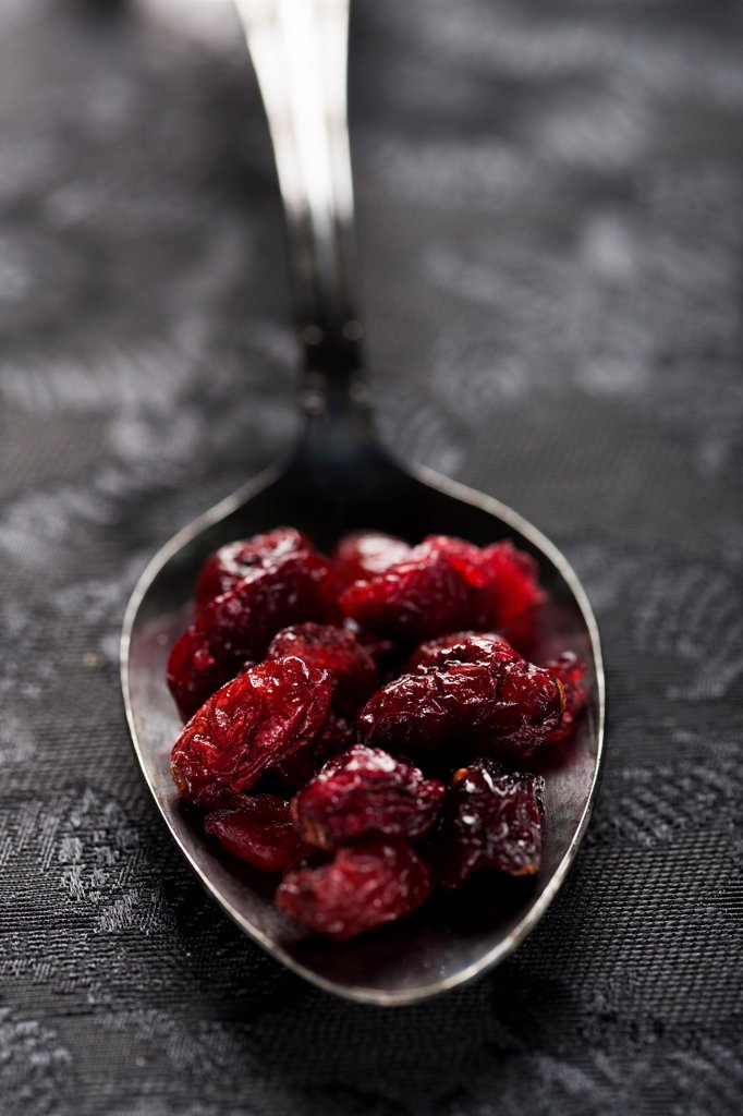 Dried Cranberries in Spoon, Close Up : Stock Photo