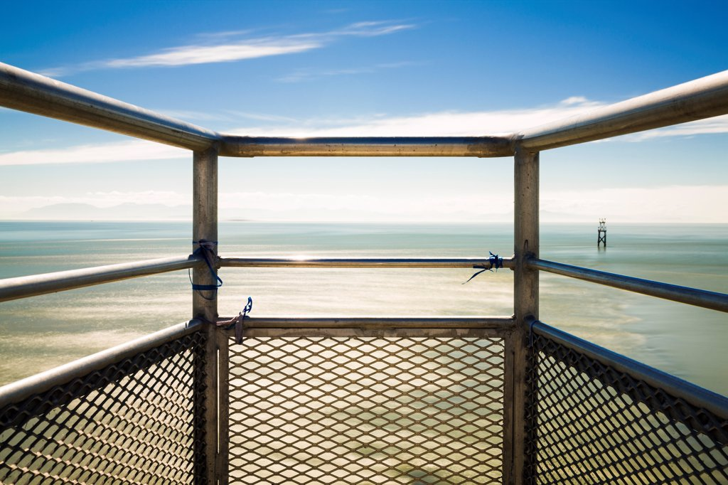 Stock Photo: 1838-14072 Metal Railing With View of Ocean