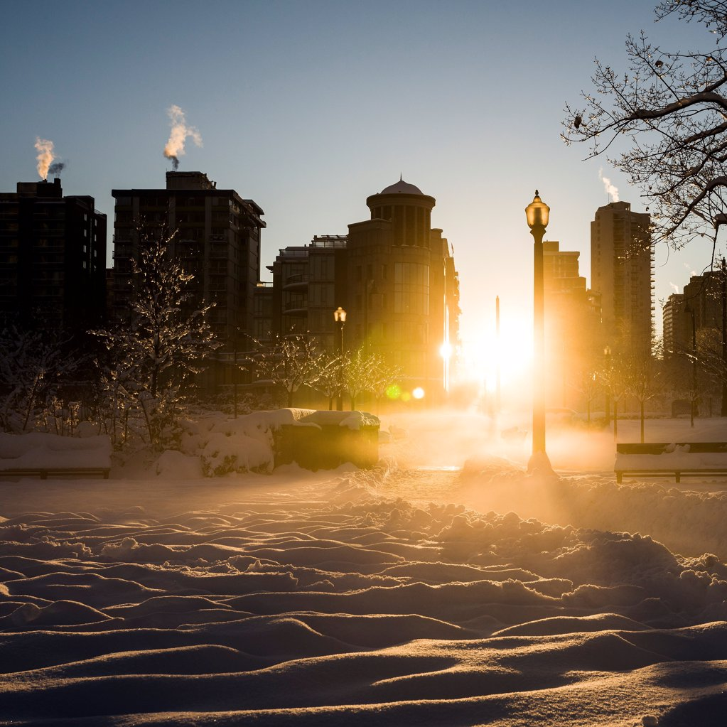 Stock Photo: 1838-14097 Sun Shining Through Snowy Cityscape, Vancouver, Canada