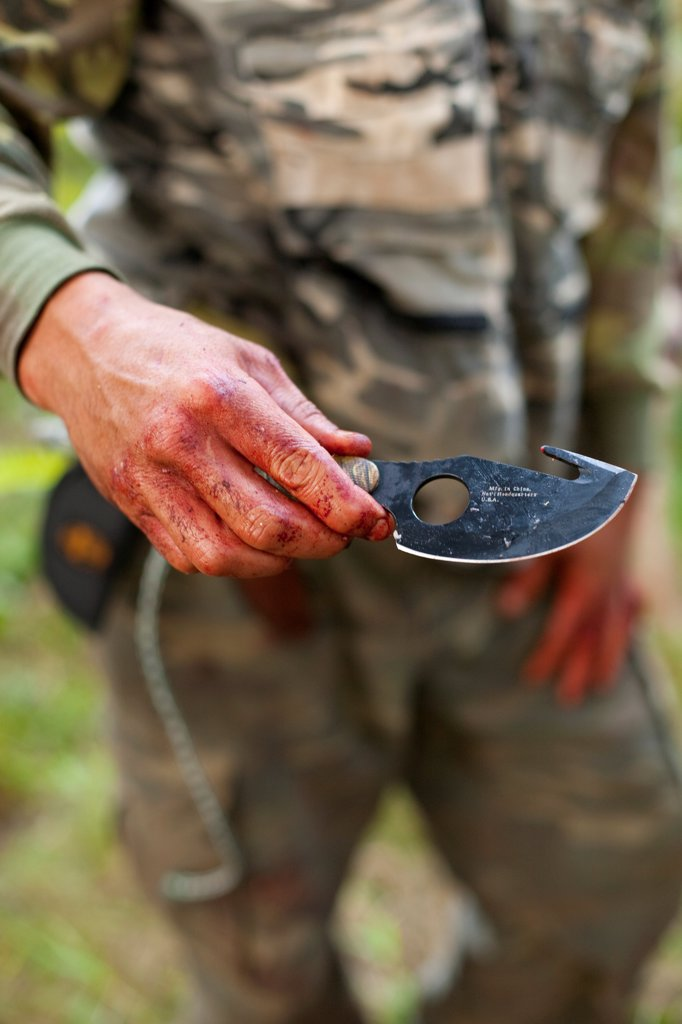 Stock Photo: 1838-14108 Bloody Hand With Hunting Knife
